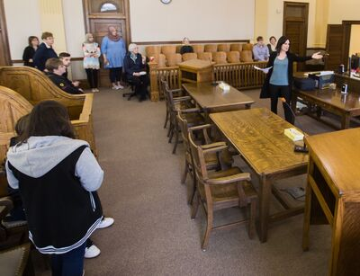 Compliance officer with maintenance enforcement Nicole Cawbel gives a guided tour of the city's court house during Law Day in Brandon on Sunday.