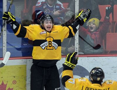 Brandon Wheat Kings' Jesse Gabrielle celebrates alongside a young fan after scoring his team's first goal on the Regina Pats during Game 4 of the first round WHL playoff series, Friday night at Westman Place.