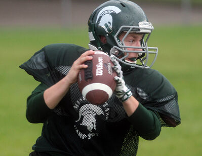 Neelin Spartans quarterback Joe Waters winds up for a throw during a team practice Wednesday evening. The Spartans face the Fort Frances Muskies today at Vincent Massey High School in their Winnipeg High School Football League opener.