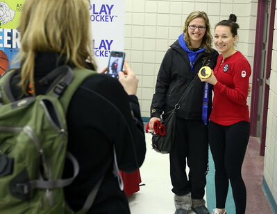 Caitlin Puchniak takes a photo of her Winnipeg Aces teammate with Larocque during the senior women's provincials at the Keystone Centre on Saturday.