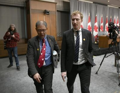 Dr. Tom Wong, Chief Medical Officer of Public Health at Indigenous Services Canada, left, and Minister of Indigenous Services Marc Miller leave a press conference on COVID-19 in West Block on Parliament Hill in Ottawa, on Thursday, March 19, 2020. Federal officials say the next two weeks will be crucial in trying to determine the scope and severity of the spread of COVID-19 in First Nations communities. THE CANADIAN PRESS/Justin Tang