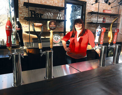Restaurateur Anna Dumas looks forward to serving her guests at Prairie Firehouse, which will open next week in the historic former Central Fire Station No. 1 on Princess Avenue.