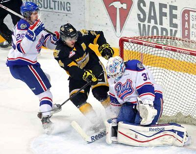 Brandon Wheat Kings overager Jens Meilleur, who played in his 200th career WHL game on Thursday night, is stopped by Pats goalie Dawson MacAuley while Regina's Dyson Stevenson watches at Westman Place on Dec. 4.