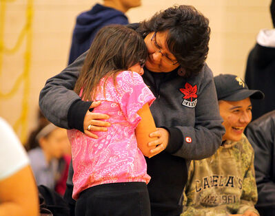 Jayna Fleury and her mother Viola embrace before Friday's assembly at J.R. Reid School.