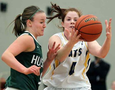 Brandon's Sarah Dobie out-battles Saskatchewan's Tracy Holloway for a loose ball Friday night.