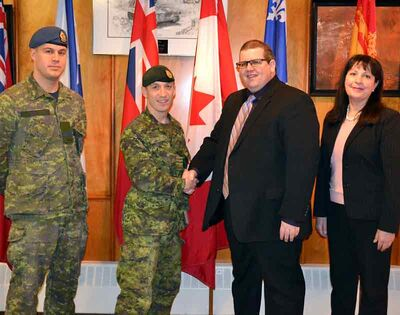 Lt. Cart Noonan (left), Lt.-Col. Richard Goodyear, CFB Shilo base commander, Assiniboine Community College president Mark Frison and ACC vice-president for enterprise development Diane Shamray celebrate the signing of an agreement between the college and the Department of National Defence that will provide educational opportunities for CFB Shilo soldiers, civilian employees at the base and their families.