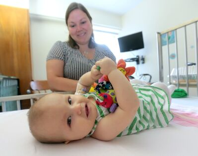 Bailey Paige-Phillips undergoes her 100th transfusion with her mother Kristen Phillips at her side at the Brandon Regional Health Centre on Friday.