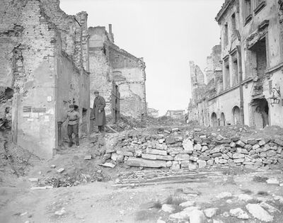 "File-this file photo from 1945 shows two German soldiers make their way through the gutted city of Warsaw, the capital of Poland, in September 1945. A Polish ruling party official said Wednesday that Poland is considering demanding reparations from Germany for the massive losses inflicted on Poland during World War II. Ruling party leader Jaroslaw Kaczynski recently said Poland planned a ""counter-offensive"" against Germany, accusing the neighbor of avoiding responsibility for its war-era crimes. (AP Photo/Henry Griffin)"
