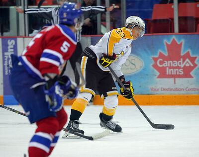 Brandon's Tim McGauley looks to make a pass Tuesday at Westman Place.