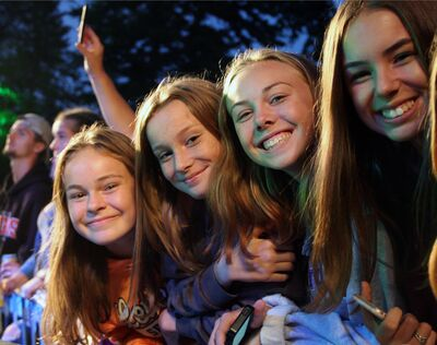Friends Ella Conrod, Carlie Perrett, Hallee Cole and Kaitlyn Perrett enjoy Saturday's outdoor concert at RMNP.
