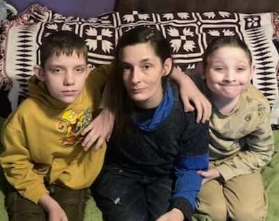Erin Lang with two of her three sons Ethan and Damon, twin of Cameron, 10. (Submitted)</p></p>