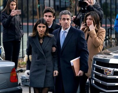 Michael Cohen, right, President Donald Trump's former lawyer, accompanied by his children and wife, arrive at federal court for his sentencing for dodging taxes, lying to Congress and violating campaign finance laws in New York on Wednesday, Dec. 12, 2018. (AP Photo/Craig Ruttle)