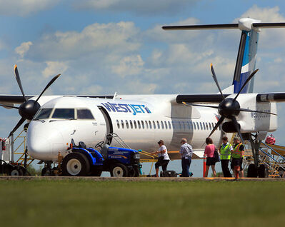 A regularly scheduled WestJet flight to Calgary boards its passengers at Brandon Airport on Monday.