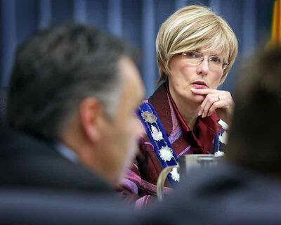 Mayor Shari Decter Hirst listens to city manager Scott Hildebrand on Monday evening at city hall.