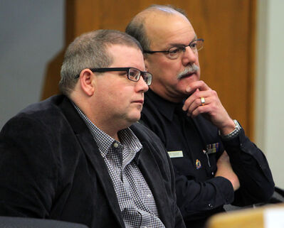Mark Frison, chair of the Brandon Police Board, and Brandon Police Service Chief Ian Grant listen during budget deliberations, Saturday afternoon at city hall's council chambers.