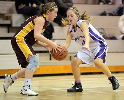 Crocus's Kendall Omeljanow and Massey's Shelby Nohr go one-on-one in JV girls' basketball last night.
