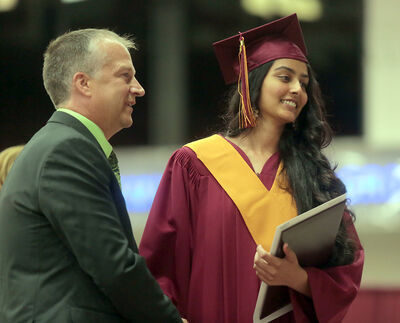Amee Patel makes her way to receive her diploma during Wednesday's graduation ceremony for Crocus Plains Regional Secondary School. Patel graduated with her health-care aide certificate as well as a nursing award.