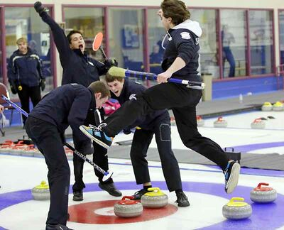Skip Matt Dunstone (right) leaps in the air in celebration with teammates after winning Monday's junior men's title.