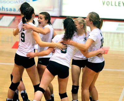 The Neelin Spartans celebrate their semifinal victory over the Glenlawn Lions on Wednesday night.