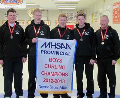 Members of the Carberry Collegiate Cougars curling team hoist the banner after winning the MHSAA provincial boys championships held in Gladstone and Plumas. Pictured are (L-R): Nathan Malfait, lead; Braden Orchard, second; Max Van Kommer, third; Braden Calvert, skip; and coach Grant Calvert.