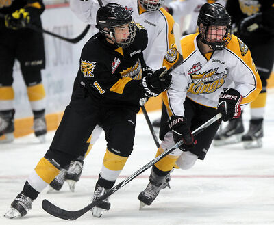 James McIsaac (right) shadows Connor Gutenberg during Sunday's intrasquad game at Westman Place.