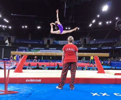Brandon gymnast Isabela Onyshko goes through some last-minute preparation on the beam for the Commonwealth Games as Brandon Eagles and Team Canada coach Lorie Henderson watches on Sunday in Glasgow, Scotland.
