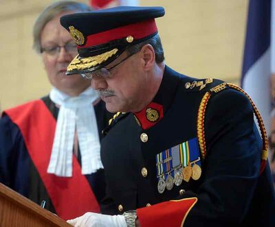 New Brandon Police Service Chief Ian Grant signs the oath of office papers during his swearing-in ceremony at the Brandon Armoury on Jan. 25. In a YouTube video posted by the city on Wednesday, Grant discusses policing challenges, his goals and vision.