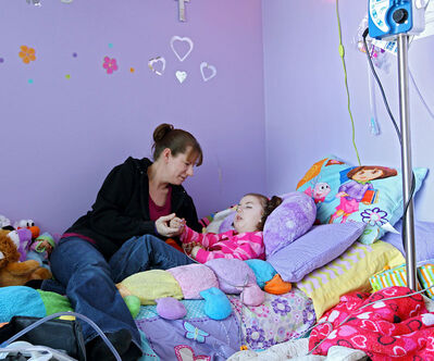 In this 2013 photo, Rhonda Towler visits with her daughter Emma Belhumeur, who died last year as a result of Ohtahara syndrome.