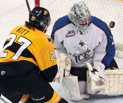 Brandonite Brett Kitt goes upstairs with a backhand to score his first of two goals for the Wheat Kings on Friday.