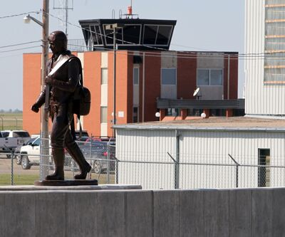 A statue crafted in Alberta and raised Thursday morning is seen at the Commonwealth Air Training Plan Museum. The museum is hosting an unveiling ceremony for the new memorial wall that surrounds the statue, to take place September 10.