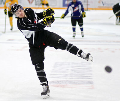 Captain Ryan Pulock fires a puck in Brandon Wheat King practice on Thursday.