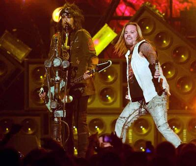Vince Neil (right) and Nikki Sixx of Mötley Crüe perform at Winnipeg's MTS Centre during a January 2010 concert. Mötley Crüe — Sixx, Neil, Mick Mars and Tommy Lee— will play Westman Place on May 6. Tickets go on sale Friday, March 1.