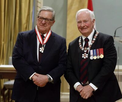 Lloyd Axworthy of Winnipeg is invested as Companion of the order of Canada by Governor General David Johnston during a ceremony at Rideau Hall the official residence of the Governor General, in Ottawa, Friday, February 17, 2017. Former foreign affairs minister Axworthy has been tapped to lead a new international group in search of practical solutions to the world's massive refugee crisis. THE CANADIAN PRESS/Fred Chartrand