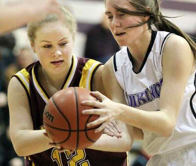 Tara VanCauwenberghe (right) of the Vincent Massey Vikings battles for the ball with Frances Krinke of the Crocus Plainsmen in the varsity girls season opener Monday night.