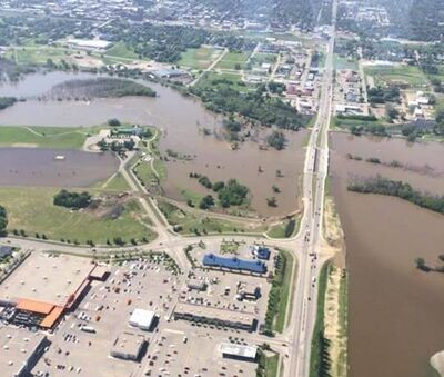 Floodwaters are held away from 18th Street North in Brandon, although Grand Valley Road has disappeared beneath the rising Assiniboine River.