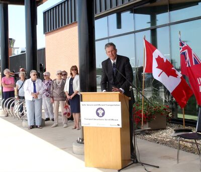 Premier Brian Pallister speaks to the crowd during the Brandon Municipal Airport's grand opening on Friday.