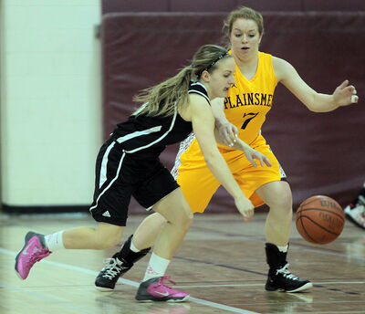 Jessi Coulter of the Vincent Massey Vikings moves the ball under pressure from Mackenzie Pearson of the Crocus Plainsmen in varsity girls' basketball on Tuesday night.