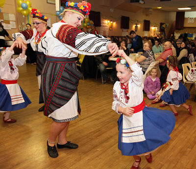 Michelle Olinyk spins Jordan Woloski as the two Brandon Troyanda School of Ukrainian Dance members dance between performances at the Ukrainian pavilion during the opening night of the Lieutenant Governor's Winter Festival on Thursday evening.