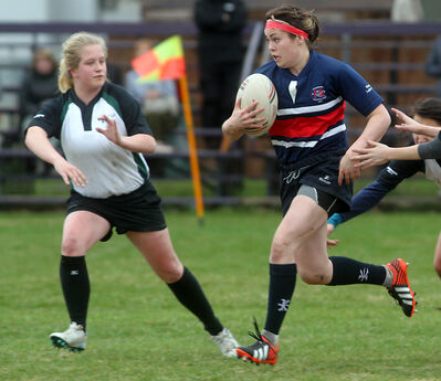 Minnedosa's Mallory Workman tries to run past Dauphin's Loralie Hrychuk Tuesday at John Reilly Field.