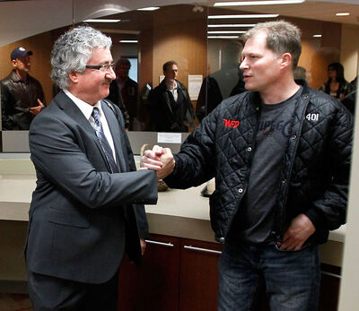 Wade Ritchie, left, meets with his brother Cam Ritchie, a Winnipeg firefighter, prior to his reinstatement hearing at the Labour Board office in Winnipeg on Tuesday.