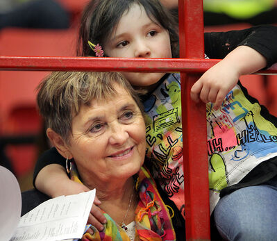Norma Lennon hugs her granddaughter Ivy as the pair watch the SuperDogs show at the Royal Manitoba Winter Fair on Monday.