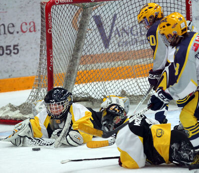 Brandon goalie Matthew Simard dives to cover the puck during the 2005 age group final of the Source for Sports AAA Hockey Challenge. This year's tournament begins on Friday at the Sportsplex as well as the Kinsmen and Optimist arenas.