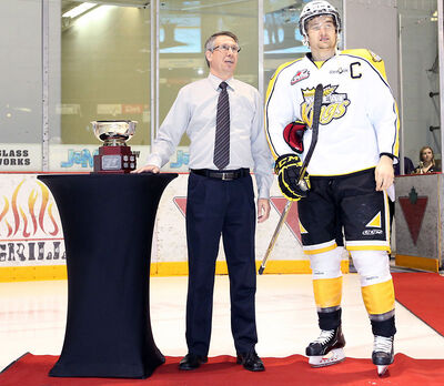 Brandon Sun publisher Eric Lawson presents Wheat Kings captain Mark Stone with the Brandon Sun Scoring Champion trophy on Saturday evening. Stone was also named the team's MVP.