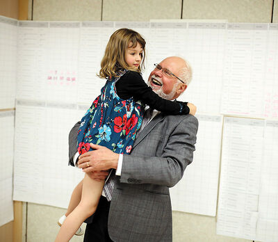 Dauphin-Swan River-Neepawa Conservative candidate Robert Sopuck hugs his granddaughter, Eden van Hoof, 6, after being announced as the winner of his riding at his campaign headquarters in Dauphin on Monday.