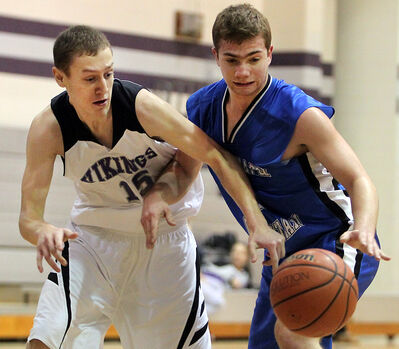Vincent Massey's Andrew Nelson and Steinbach's Davis Loewen go after a loose ball during the Triple Crown Zone Challenge round-robin basketball tournament on Saturday.