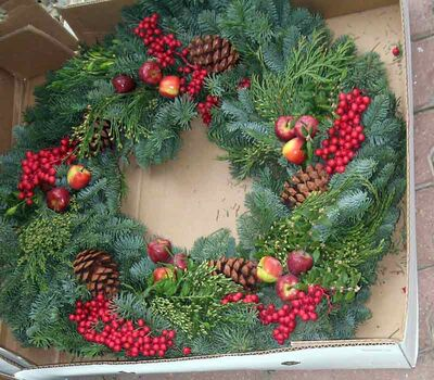 Fresh fruit can be added to a wreath. Photo was taken at Patmore's Nursery.