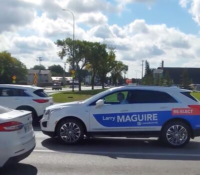 Brandon-Souris Conservative candidate Larry Maguire is seen looking down at his lap while driving last Friday in Winnipeg in this screenshot from a video sent to the Sun. In an email to the Sun, Maguire apologized for distracted driving and promised not to do it again.