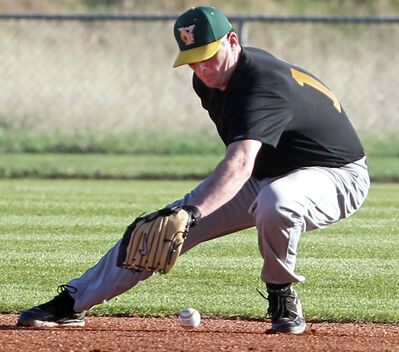 Young Guns' Dana McNish fields a grounder to second base at Brandon Field on Tuesday evening.