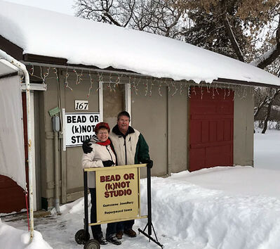 Lynne and Dennis stand outside their business