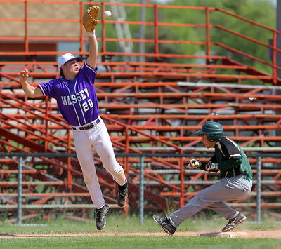 Vincent Massey Vikings' Tanner Kaspick leaps for the throw to third as Boissevain Broncos' Jay Pringle reaches safely during Friday's Prairie West High School Baseball League final at Andrews Field. The Vikings won the game 3-2.